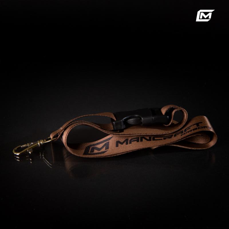 Genuine lanyard with the Mancraft logo.